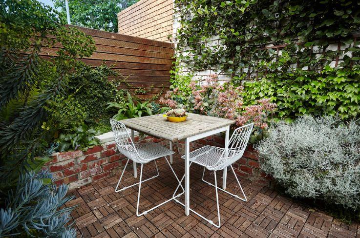 Modular wood deck and brick wall