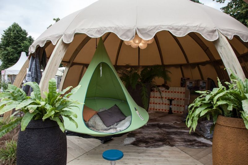 Outdoor living tent with a small hanging chair