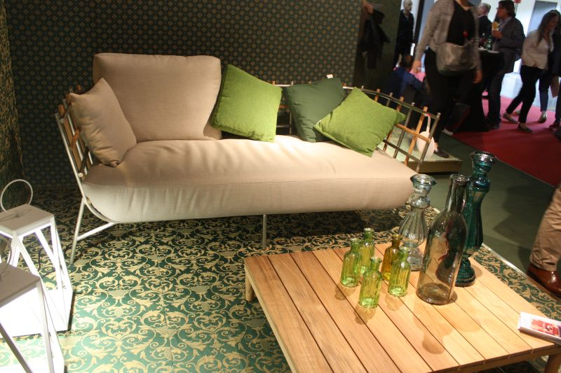Outdoor sofa with chartreuse pillows and empty bottles for table decor