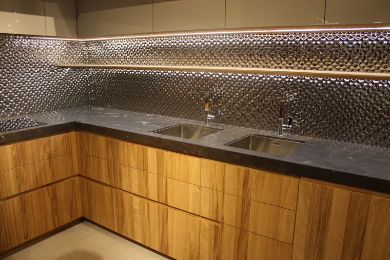 Pocelanosa wood cabinets and stainless steel backsplash