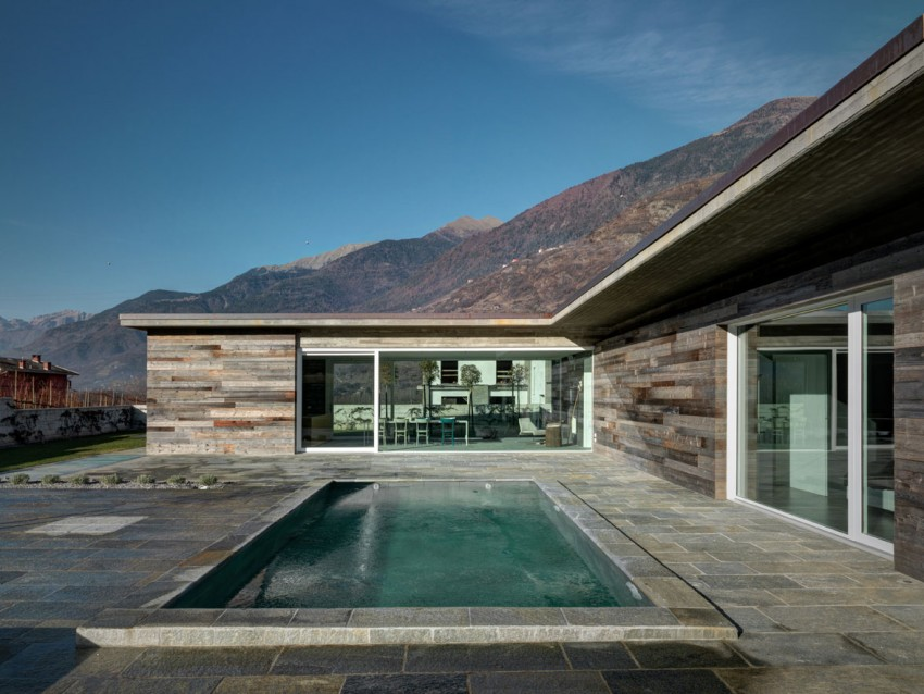 Reclaimed wood facade house and concrete swimming pool