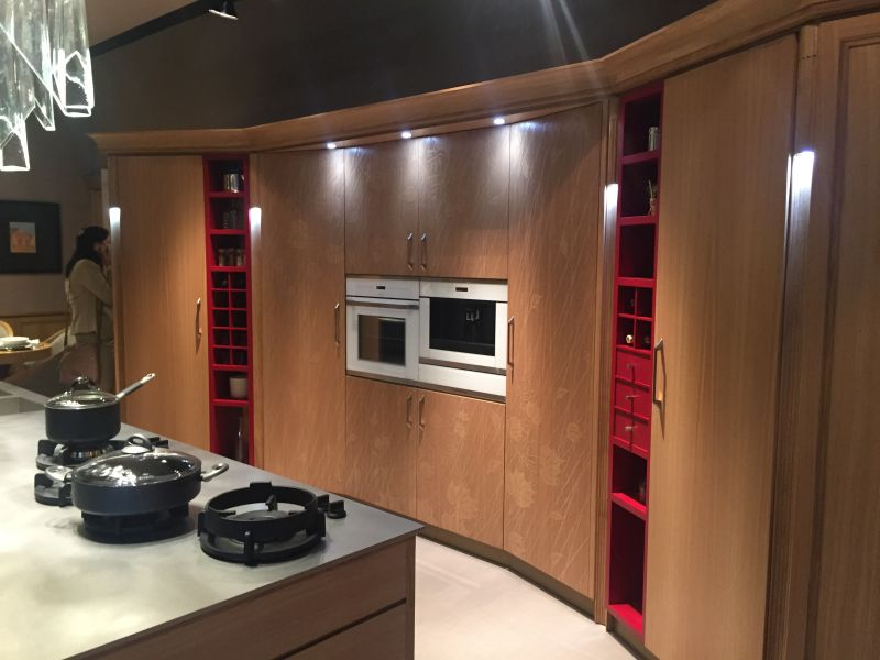 Red accents on a full brown kitchen