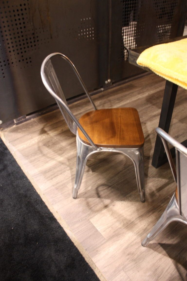These retro chairs Anson chairs from Newell Furniture have an updated, modern industrial feel. Design firm Netthaus presented these in a setting that incorporated rustic as well as modern elements.