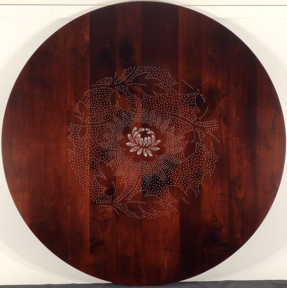 Round table with chrysanthemum floral design.