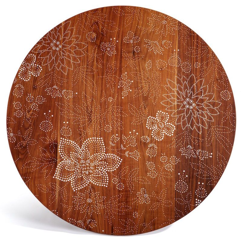 Intricate floral motif made with many sizes of nailheads.