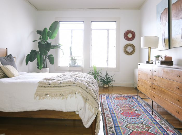 Small bedroom with big corner plants