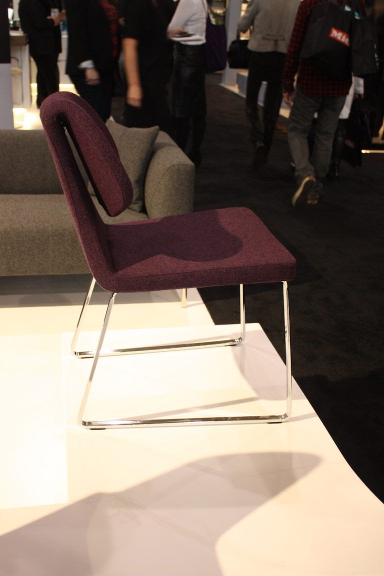 The bent back of this Soho Concept chair is an amazing detail when viewed from the side.