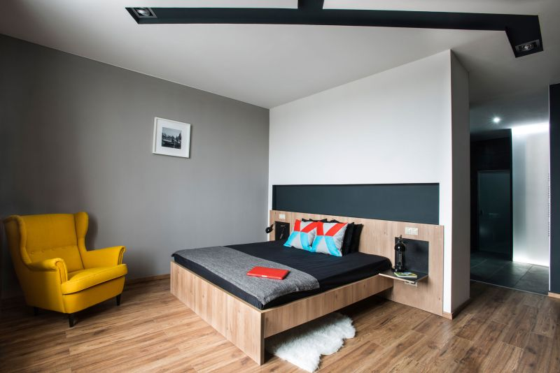 Studio Loft in Barcelona bedroom with yellow chait