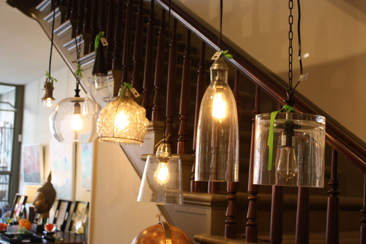 This is a great display of glass pendant lighting of various shapes and styles. The stairs lead to the second floor, which features art shows and additional vintage furnishings.