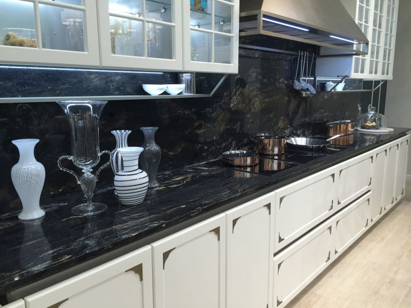 Traditional large kitchen with black accents marble countertop