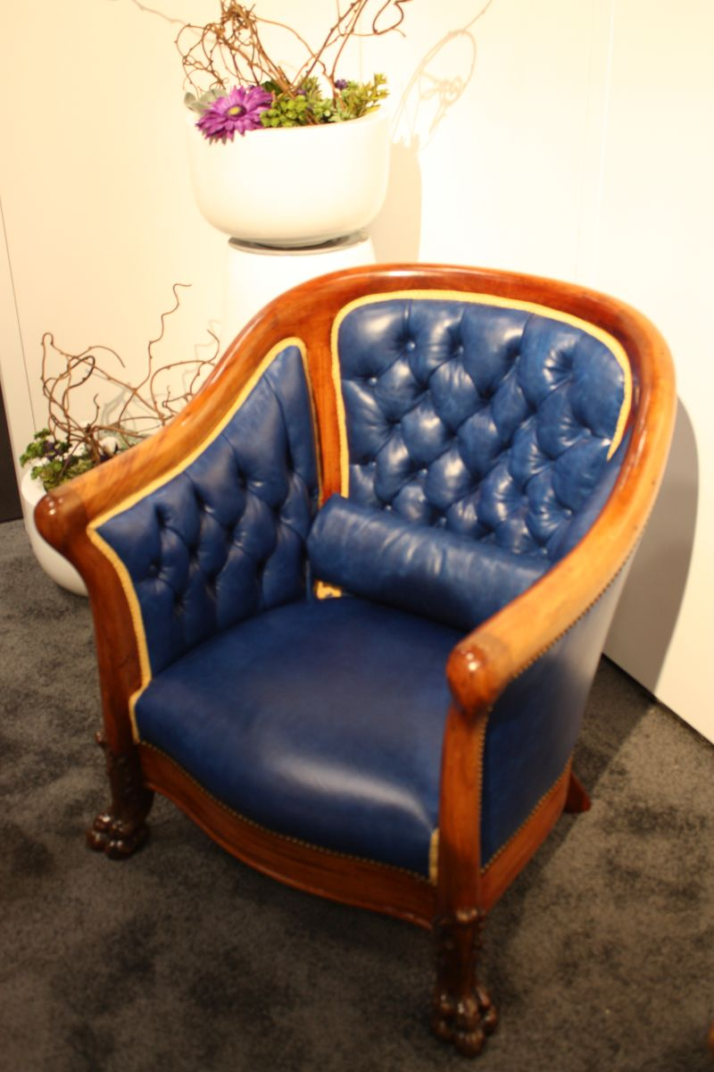 Traditional solid wood armchair with deep blue tufted leader