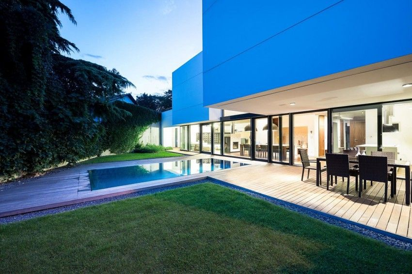 White curbes house with pool