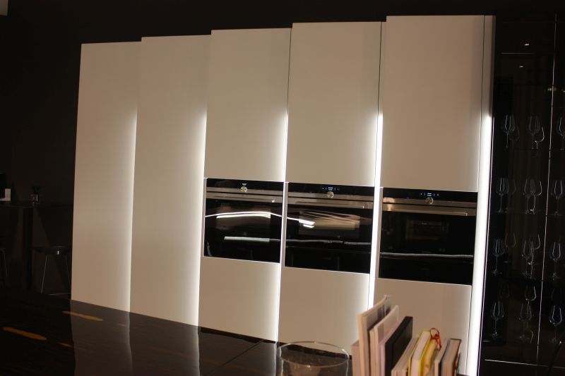 White kitchen design with built in appliances and led under cabinet lighting