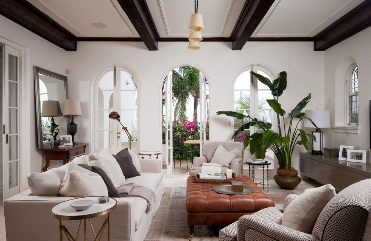 White Walls And Black Beams Living Room With Tall Plants In Corner