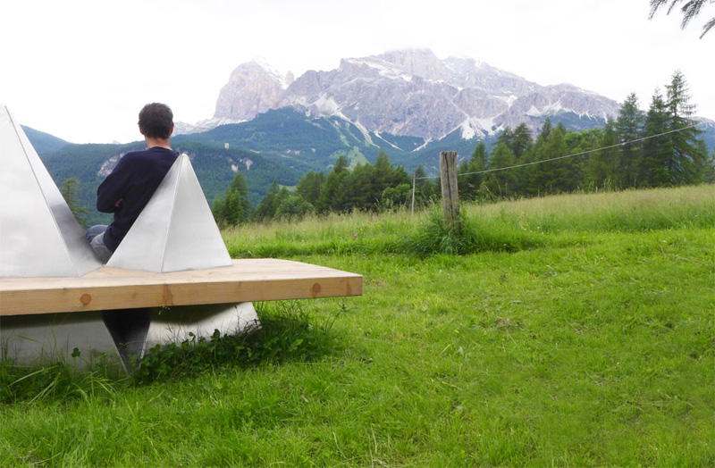 Wood bench with mountains around it Outdoor