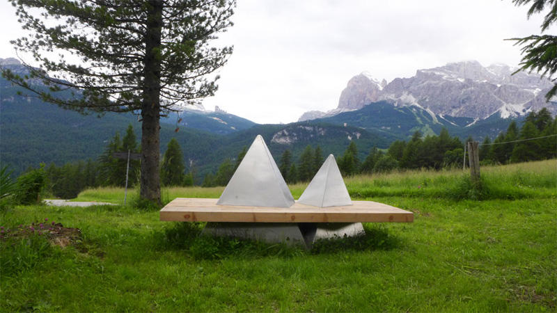 Wood bench with mountains around it