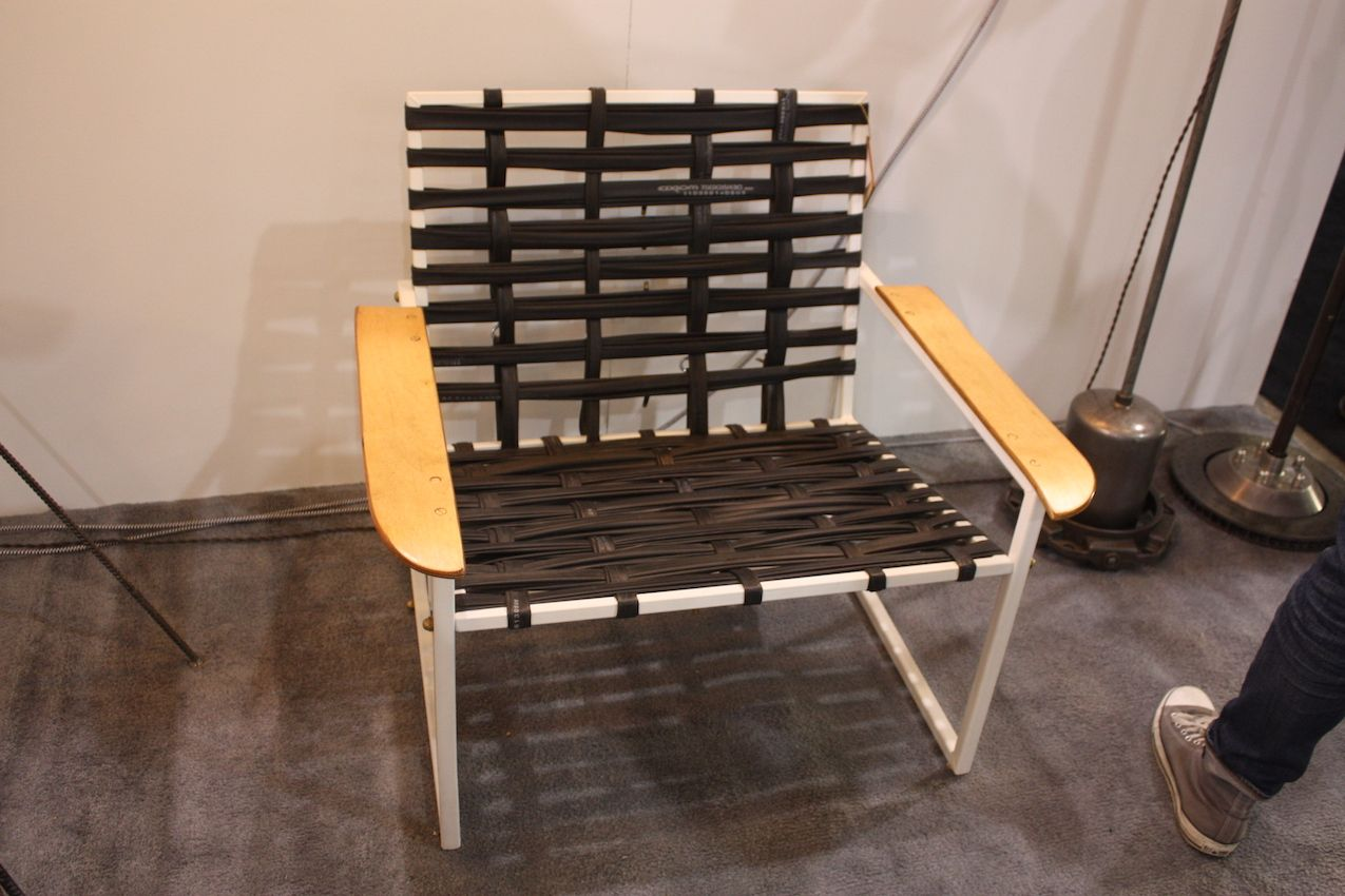 "Canadian designer Adam Fullerton calls his furniture ""not your average recycling project. This is Contemporary Inner-Chair, which was ""Re born on 10/10/15. "" It's a contemporary chair made from box section off-cuts and packaging from toronto newest e-bikes, discarded bike inner tubes, and skateboard deck armrests."