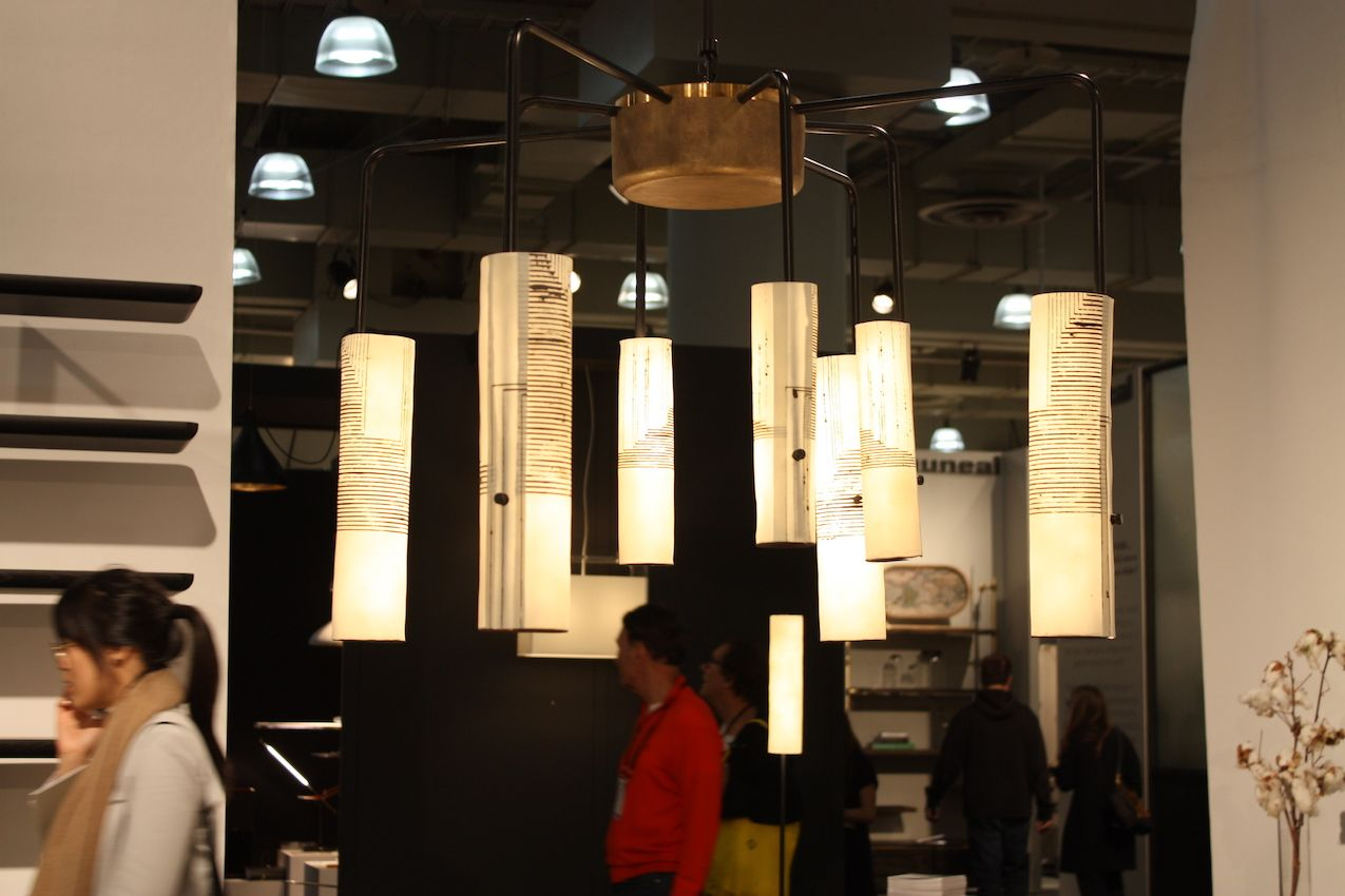 Arak chandelier composed of hand-made translucent shades, aluminum arms and a bronze hub.