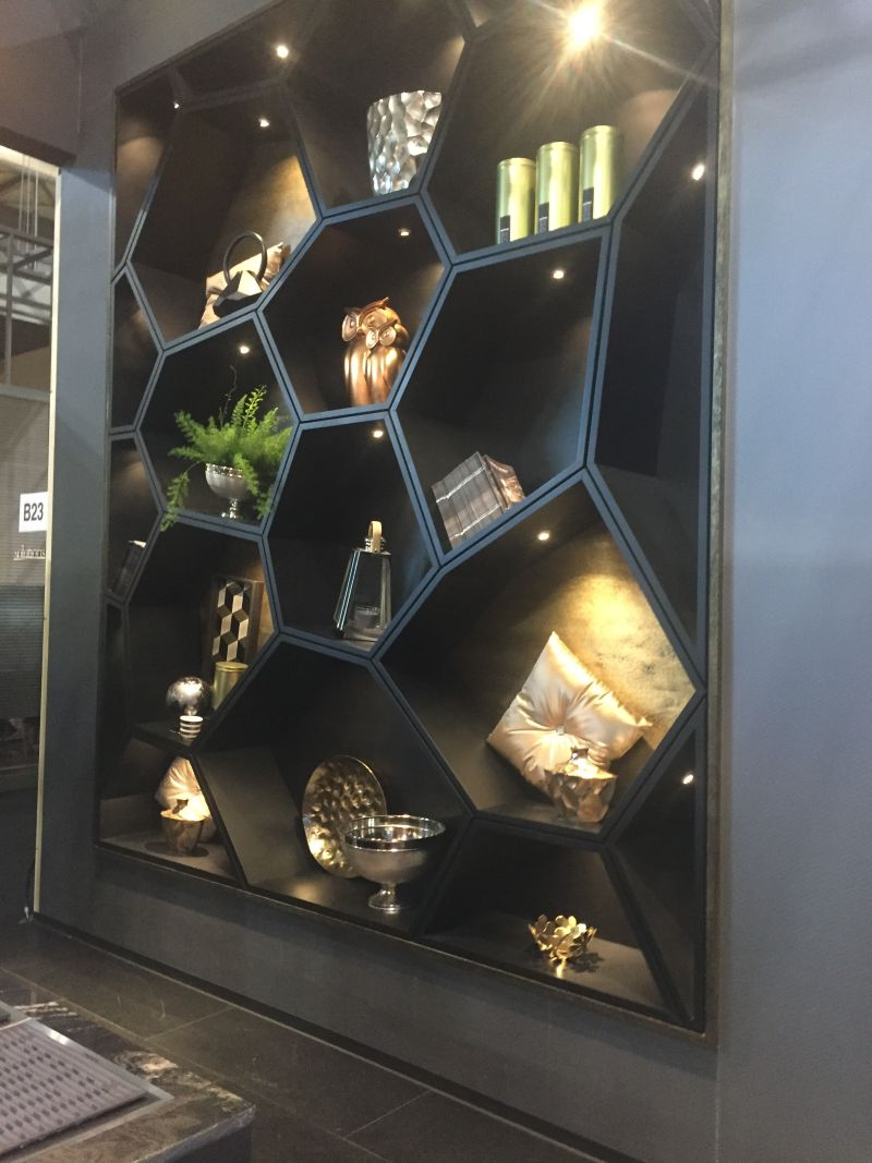 Black bookshelves with honeycomb pattern