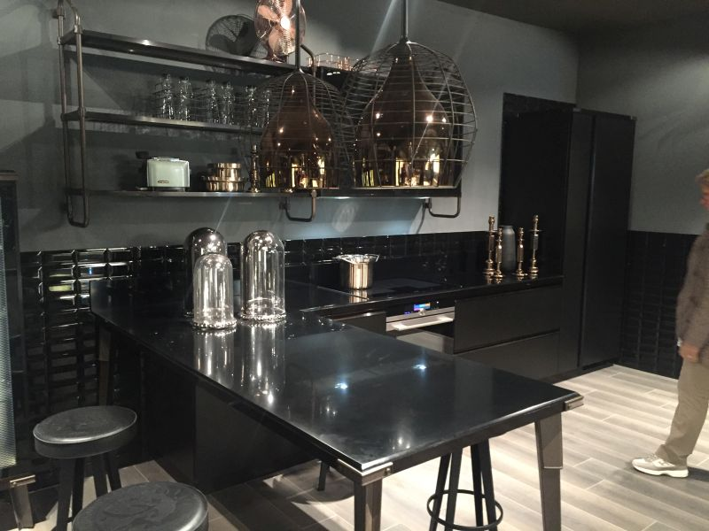Black kitchen with stools