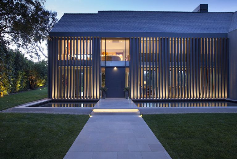 Contemporary Farmhouse Retreat - vertical facade and pathway