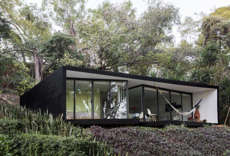 Contemporary cabin in Mexico hammock on porch