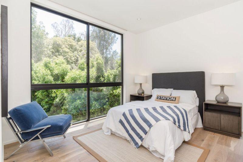 Contemporary home in Californian hillside bedroom striped decor