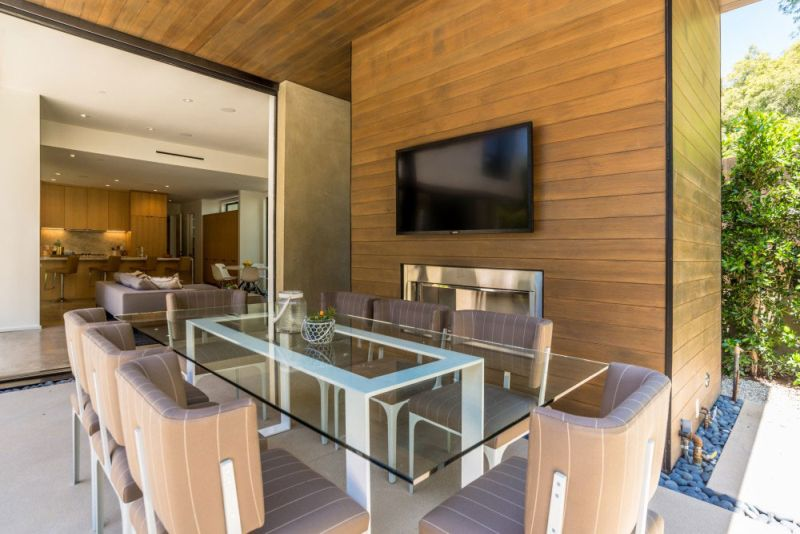 Contemporary home in Californian hillside dining area glass table