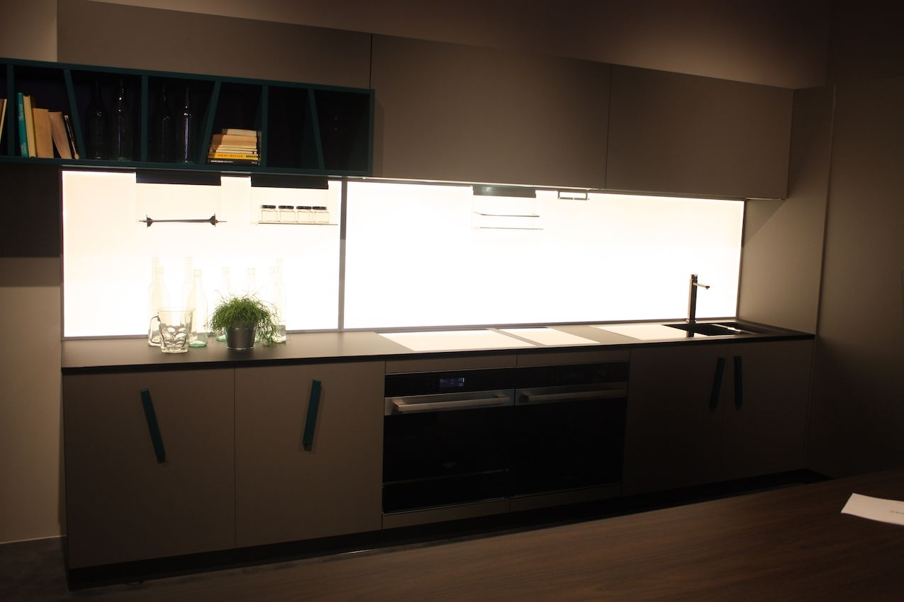 Creo Kitchens makes dramatic use of lighting placed behind the backsplash.