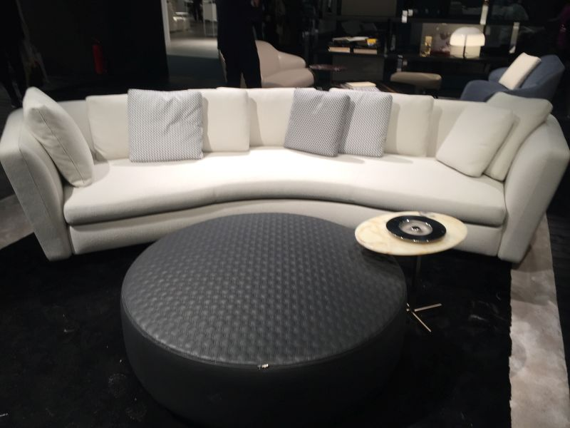 Curved sofa with tray table closer