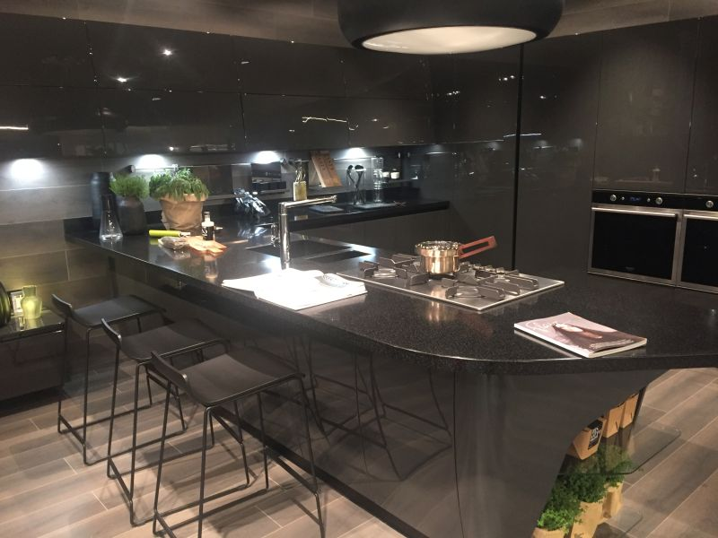 Dark kitchen design with wire bar stools