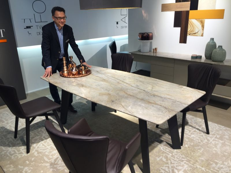 Expandable dining table with marble top. A Trip Into The World Of Stylish Dining Tables