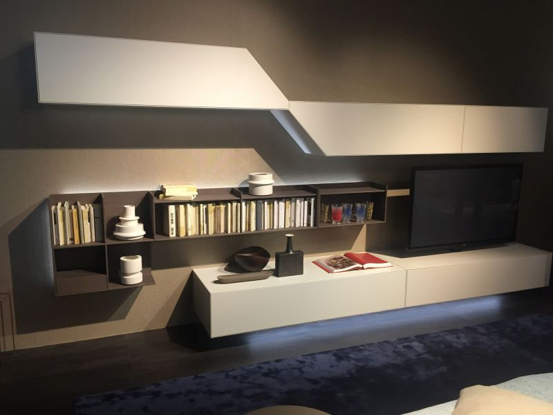 Floating living room media system with bookshelves and T area