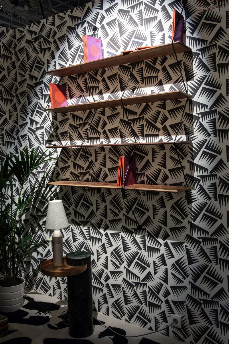 Floating shelves with black and white wallpaper for wall