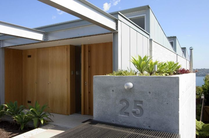 Front house big concrete planter used like house number also