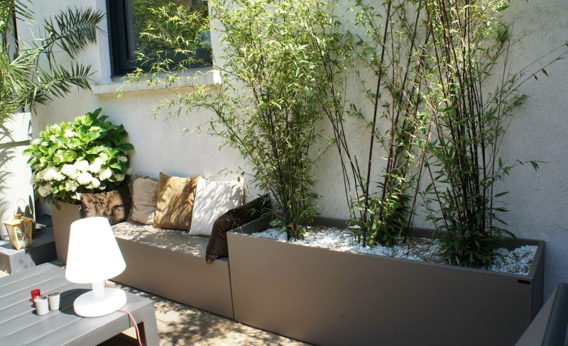 Garden bench with integrated plant