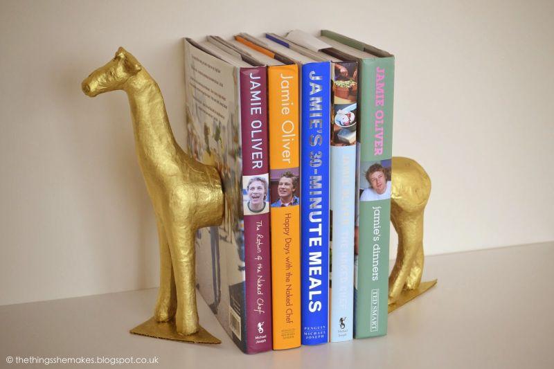 Gold giraffe bookends