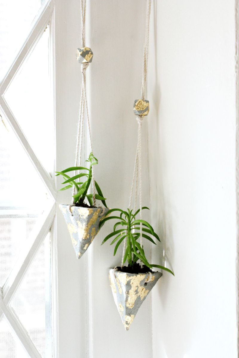 Hanging planters with gold accents