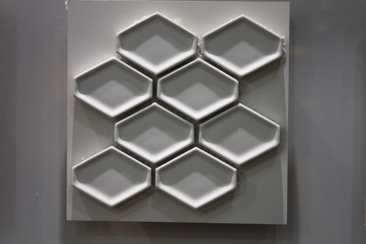 Small honeycomb-style rimmed tiles add incredible dimension to any wall.