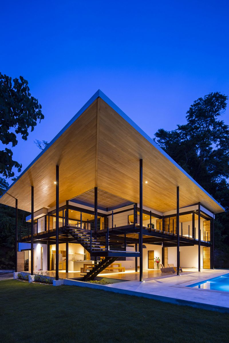 A House Trapped Between The Ocean And The Jungle Embraces Them Both