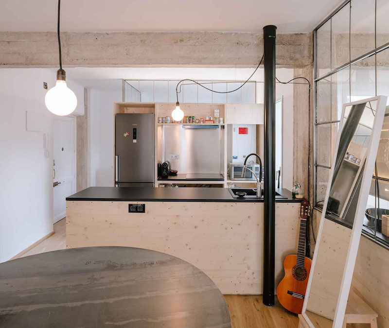 Madrid apartment with no solid walls kitchen island