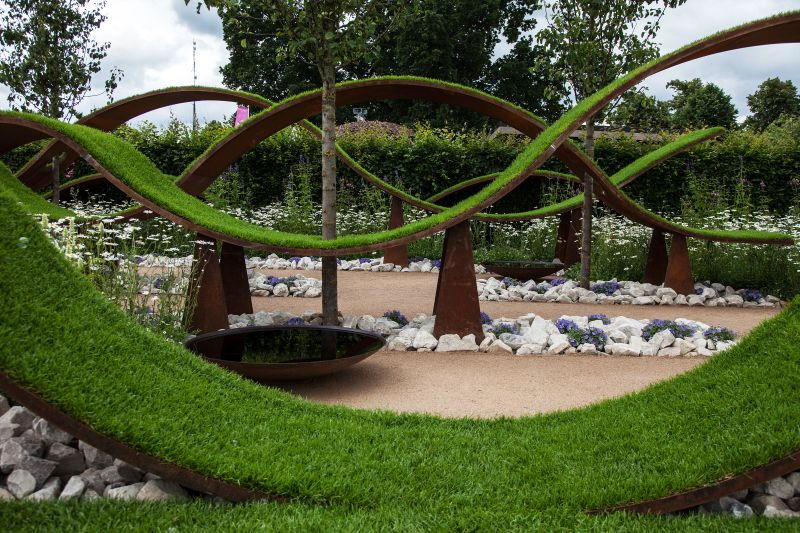 Metalic garden art with grass on it
