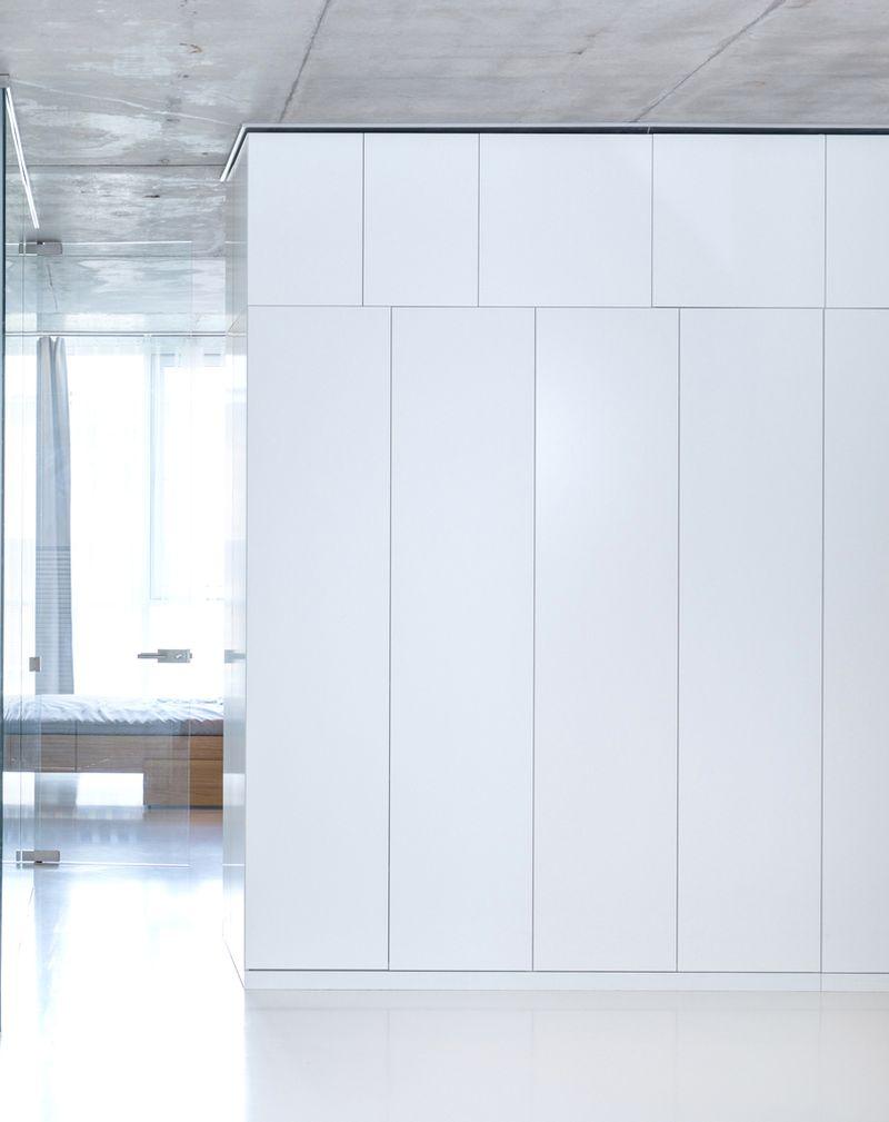 Minimalist Moscow apartment white wall unit
