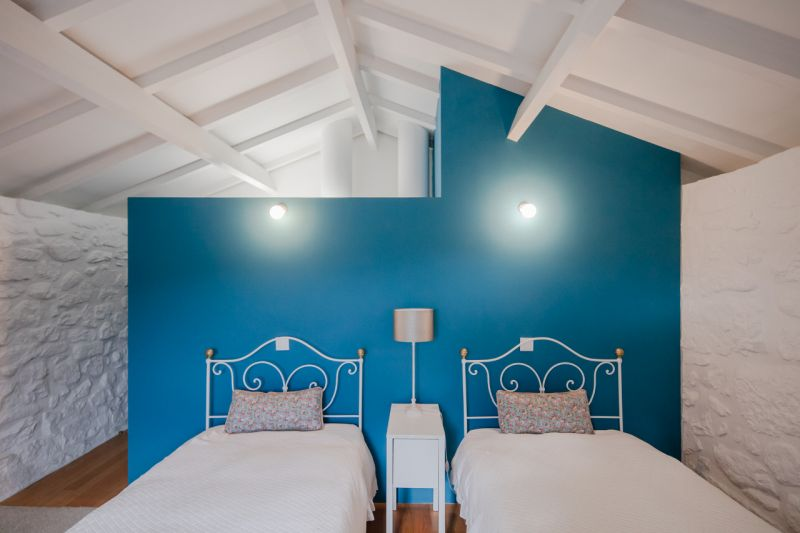 Modern barn house bedroom blue wall
