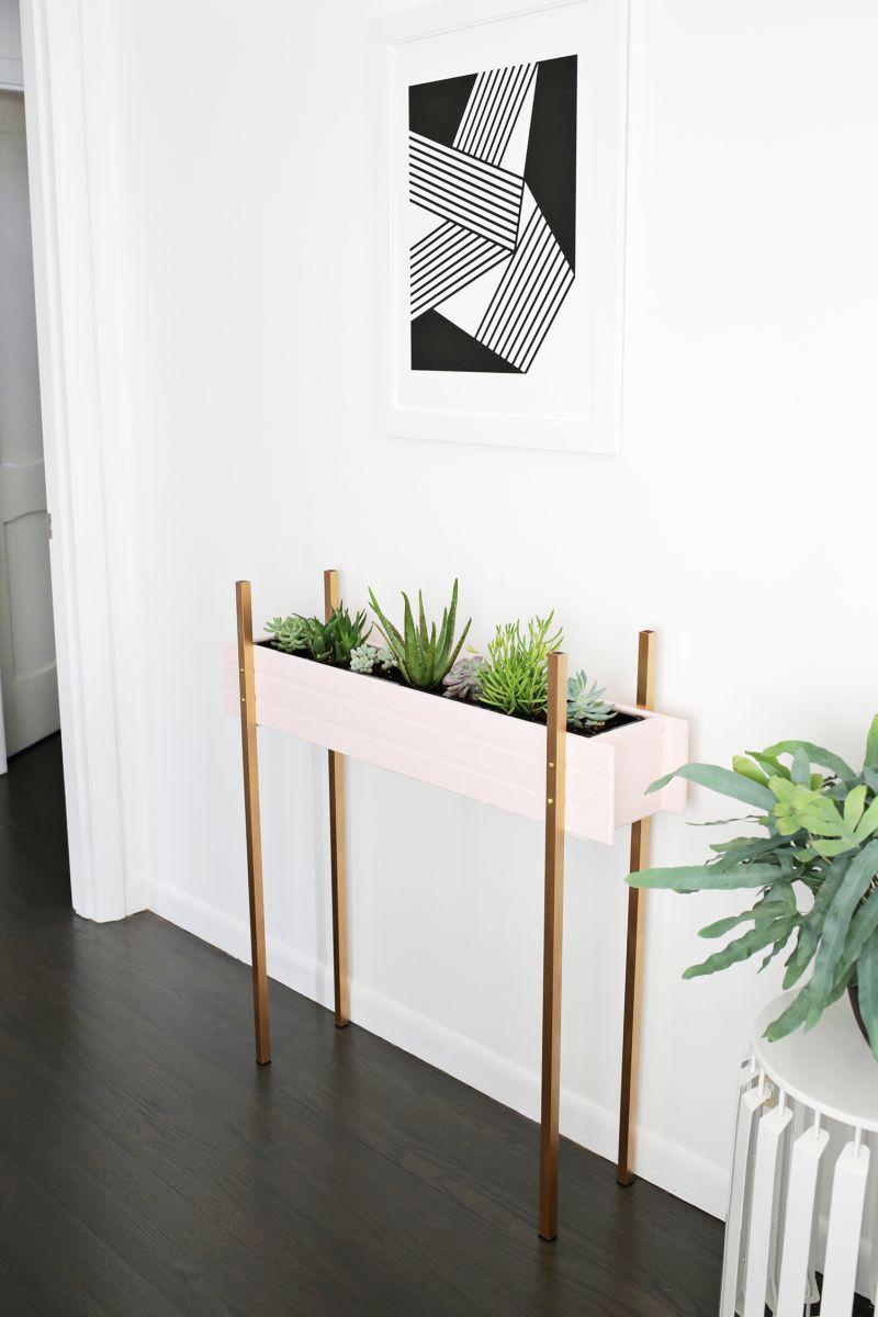Modern brass legs stand plant