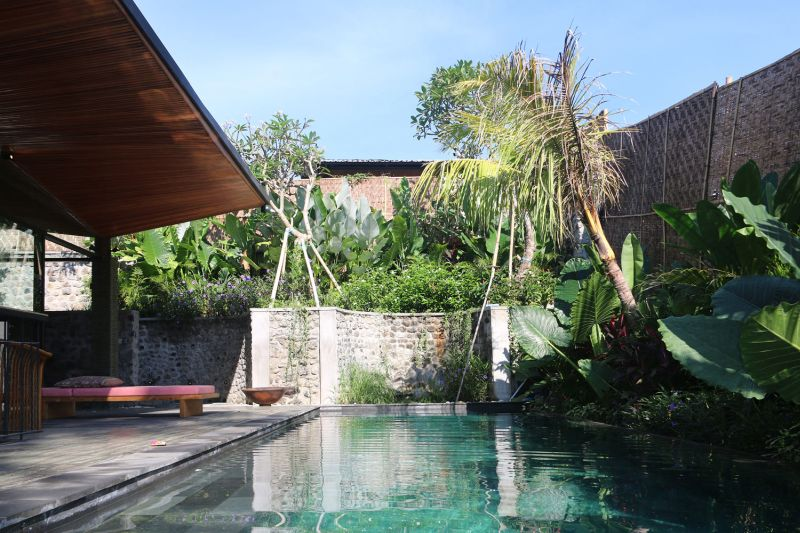 Origami House pool and stone wall