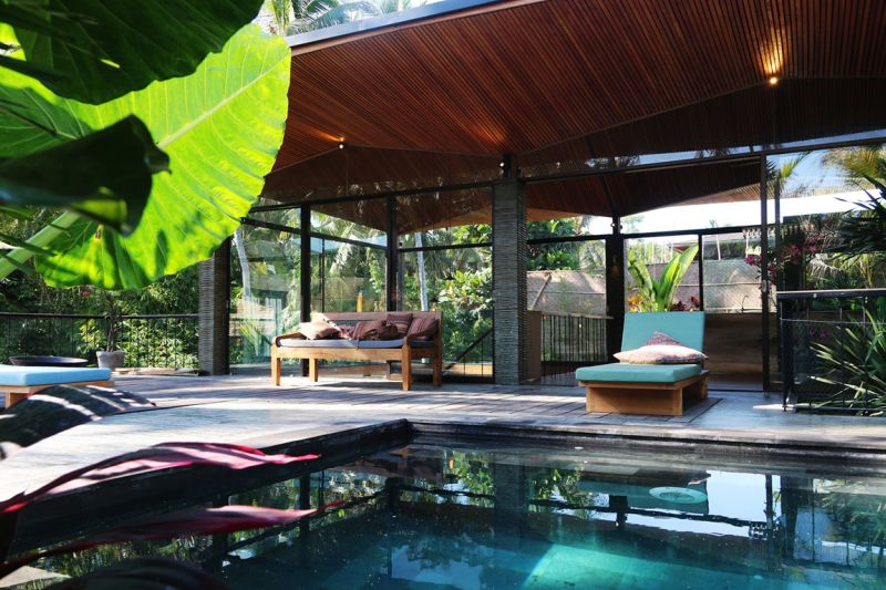 tropical retreat in bali opens its facade to embrace nature. Black Bedroom Furniture Sets. Home Design Ideas