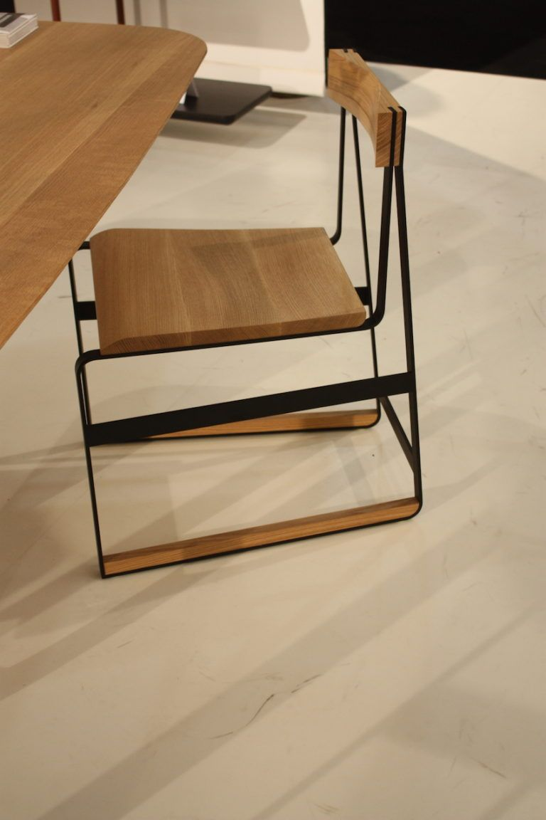 Piedmont chair in natural rift white oak timber with matte black metal.
