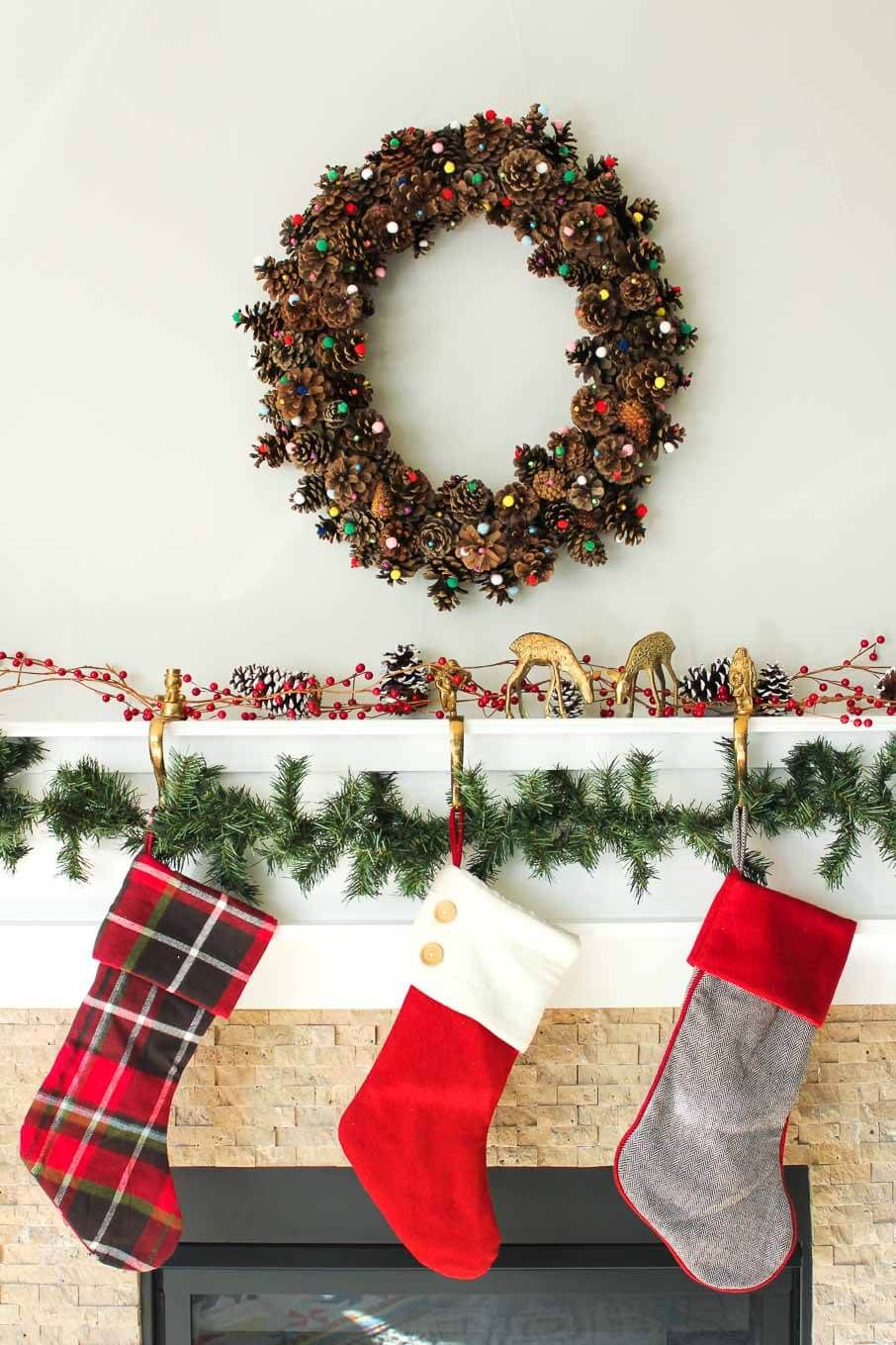 Pinecone wreath above the fireplace