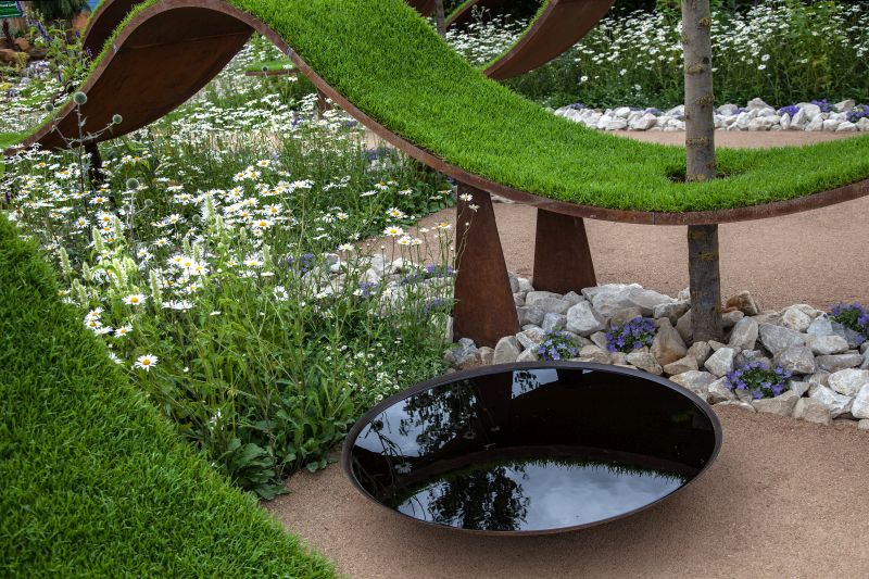 River rocks and metalic art for backyard